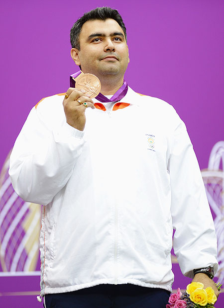 Bronze medallist Gagan Narang of India poses with the bronze medal