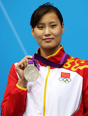 Silver medallist Ying Lu of China poses on the podium during the medal ceremony for the Women's 100m Butterfly final