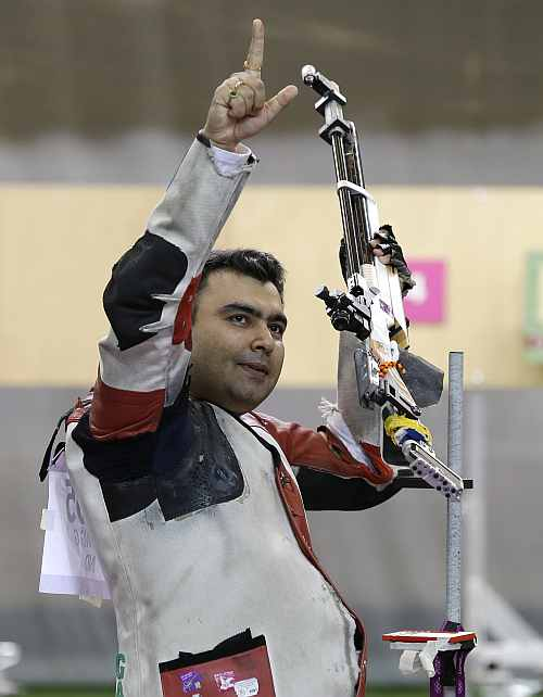 India's Gagan Narang celebrates winning the bronze medal at the end of the men's 10-meter air rifle
