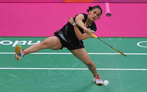 Saina Nehwal of India returns a shot against Lianne Tan of Belgium during their Women's singles Badminton match
