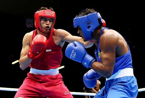 Sumit Sangwan of India (L) in action with Yamaguchi Falcao Florentino of Brazil during their Men's Heavy (81kg) Boxing