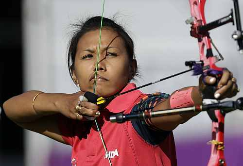 India's Bombayla Devi Laishram shoots during an elimination round of the individual archery competition