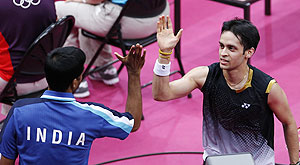 Kashyap gets a high-five from coach Pulela Gopichand