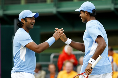 Vishnu Vardhan (right) of India taps hands with Leander Paes of India during the Men's Doubles match