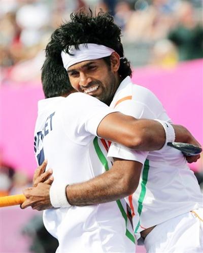 India's Shivendra Singh celebrates his goal