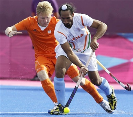 The Netherlands' Klaas Vermeulen, left, tries to steal the ball from India's Sardar Singh