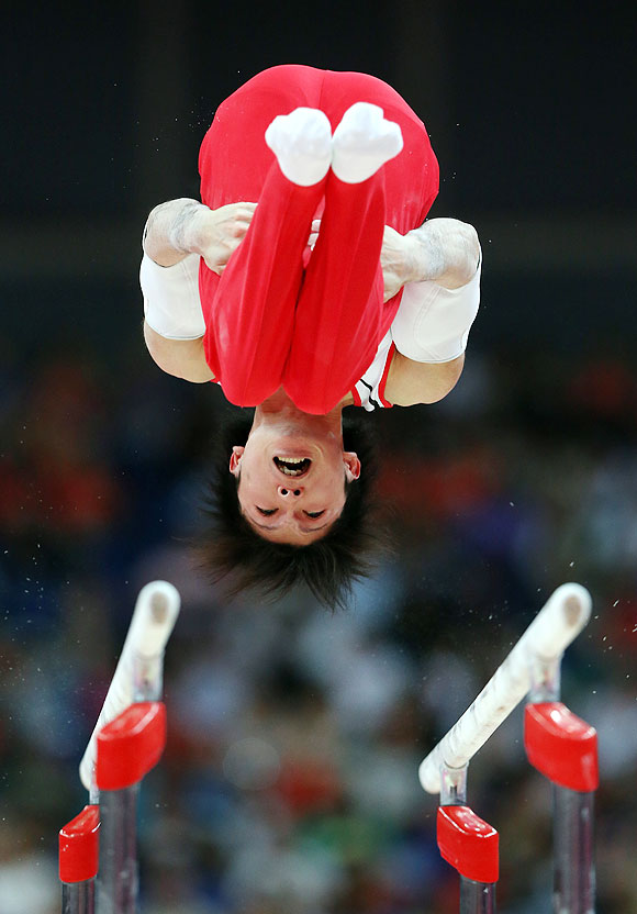 Kohei Uchimura of Japan competes on the parallel bars in the Artistic Gymnastics Men's Team final on Monday