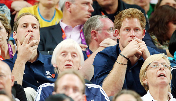 Britain's Princes William and Harry watch the Artistic Gymnastics Men's Team final on Monday