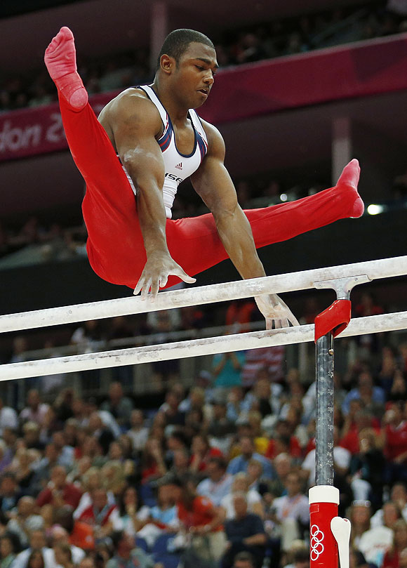 US gymnast John Orozco performs on the parallel bars during the Artistic Gymnastic men's team final on Monday