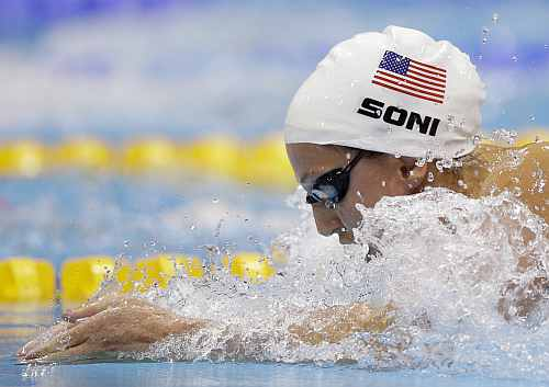United States' Rebecca Soni competes in the women's 100-meter breaststroke swimming