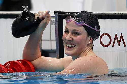 Missy Franklin of the United States celebrates after she won the Final of the Women's 100m Backstroke