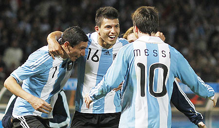 Argentina's Sergio Aguero (centre) celebrates with teammates Angel Di Maria (left) and Lionel Messi