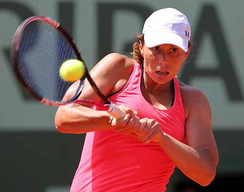 Varvara Lepchenko of the U.S. returns the ball to Francesca Schiavone of Italy during the French Open