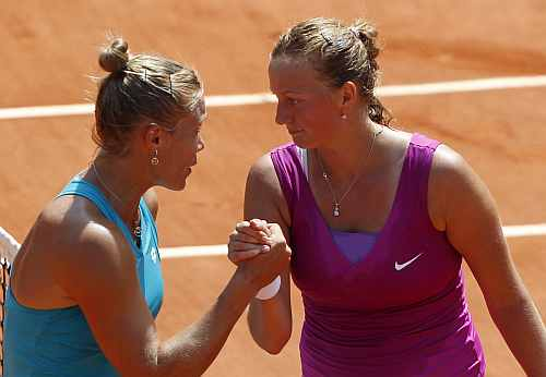 Petra Kvitova of the Czech Republic (R) shakes hands with Nina Bratchikova of Russia after winning her match during the French Open