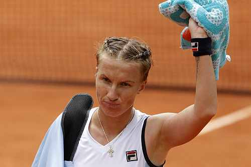 Svetlana Kuznetsova of Russia leaves the court after losing her match against Sara Errani of Italy during the French Open