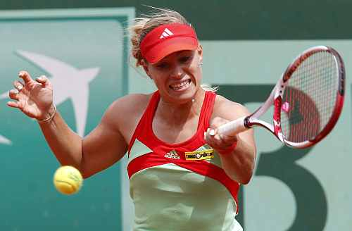 Angelique Kerber of Germany returns the ball to Petra Martic of Croatia during the French Open