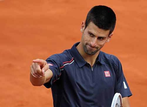 Novak Djokovic of Serbia reacts during his match against Andreas Seppi of Italy during the French Open