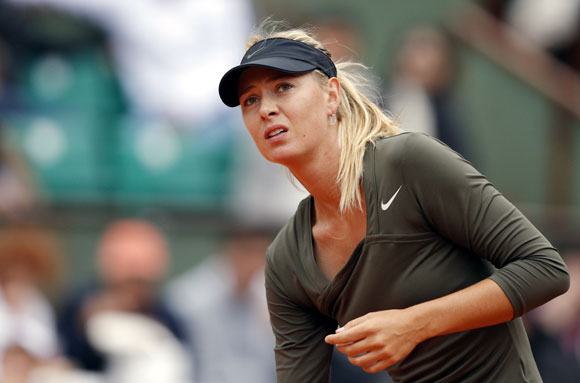 Maria Sharapova of Russia reacts during her match against Klara Zakopalova of the Czech Republic during the French Open tennis tournament at the Roland Garros stadium in Paris