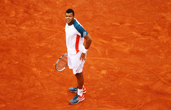 Jo-Wilfried Tsonga of France looks on in his men's singles fourth round match against Stanislas Wawrinka of Switzerland during day 9 of the French Open at Roland Garros on June 4, 2012 in Paris, France