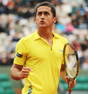 Nicolas Almagro of Spain celebrates in his men's singles fourth round match against Janko Tipsarevic of Serbia during day 9 of the French Open