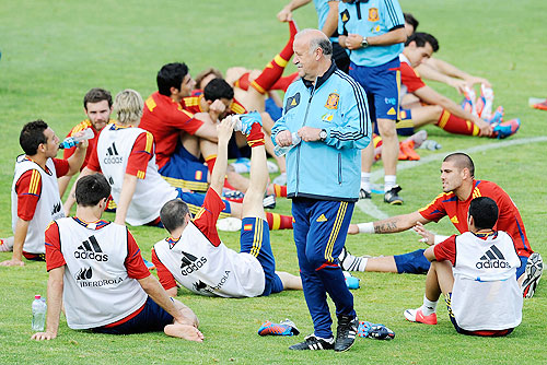 Spanish head coach Vicente del Bosque walks amongst his team