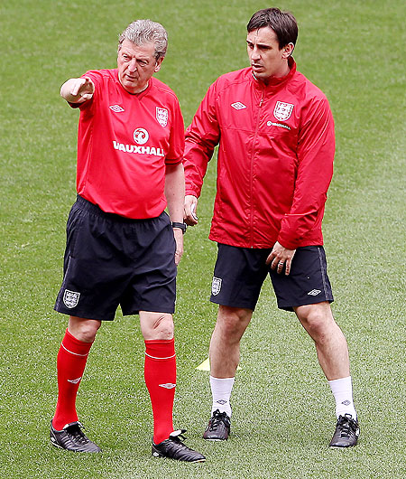 England manager Roy Hodgson (left) talks with Gary Neville