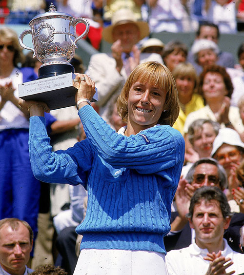 Martina Navratilova hold up her trophy after winning the French Open