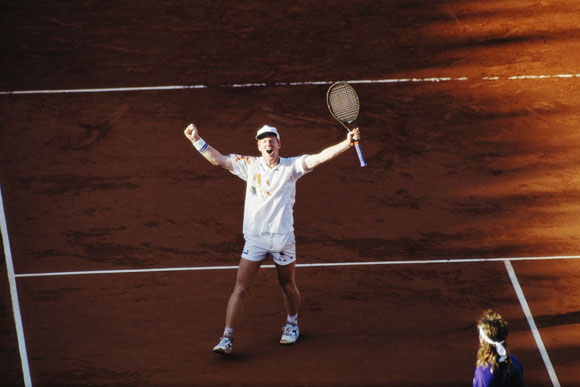 Jim Courier celebrates his defeat of Andre Agassi in the final to win the men's singles title at the French Open