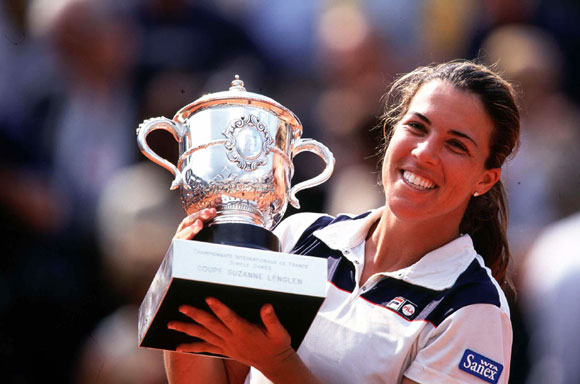 Jennifer Capriati celebrates with the trophy after winning the womens final match against Kim Clijsters of Belgium in 2001