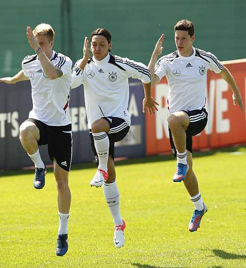 German national soccer Marco Reus (L), Mesut Oezil and Julian Draxler (R) perform during a training session in Tourrettes