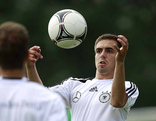 German national soccer player Philipp Lahm jumps for a ball during a training session in Tourrettes
