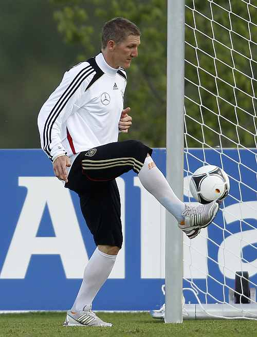 German national soccer player Bastian Schweinsteiger juggles a ball during a training session in Tourrettes