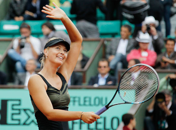 Maria Sharapova of Russia celebrates after winning her quarter-final match against Kaia Kanepi of Estonia during the French Open