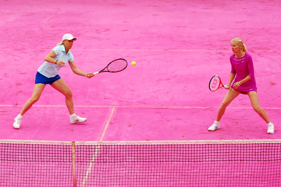 Martina Navratilova (L) of USA and Jana Novotna of Czech Republic play on a pink clay court
