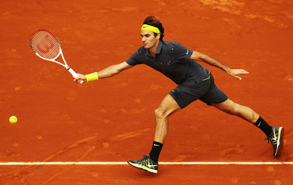 Roger Federer of Switzerland plays a forehand