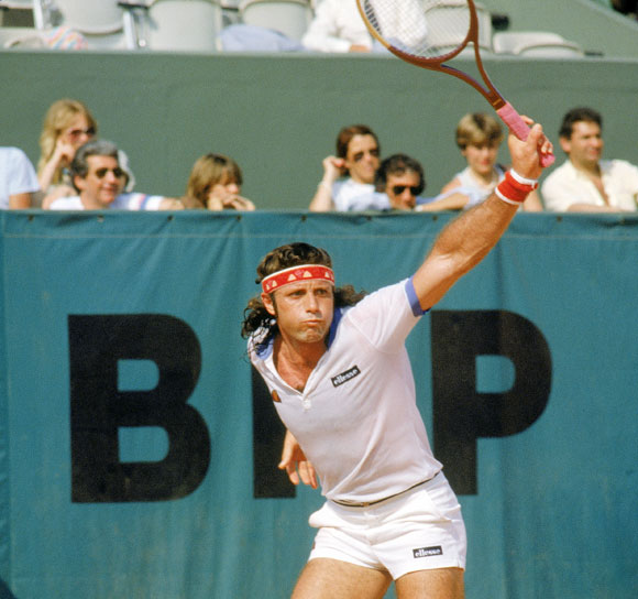 Guillermo Vilas of Argentina follows through on his backhand during a match in the 1982 French Open