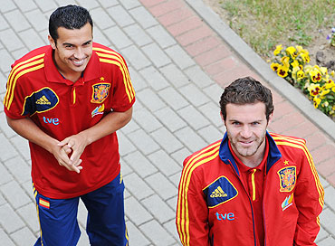 Pedro Rodriguez with teammate Juan Mata