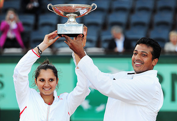 Sania Mirza and Mahesh Bhupathi celebrate with the trophy