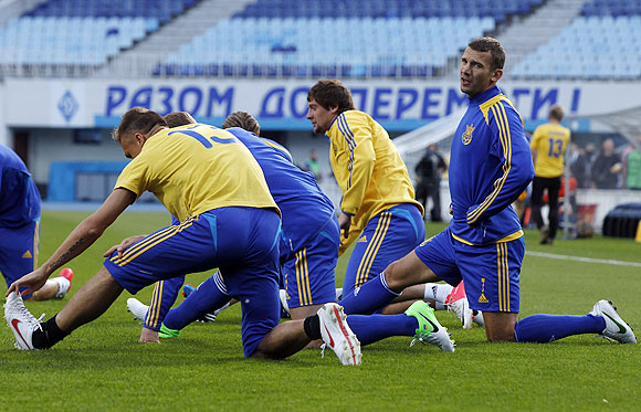 Ukraine's soccer players go through the grind during a training session at Dynamo stadium in Kiev on Thursday