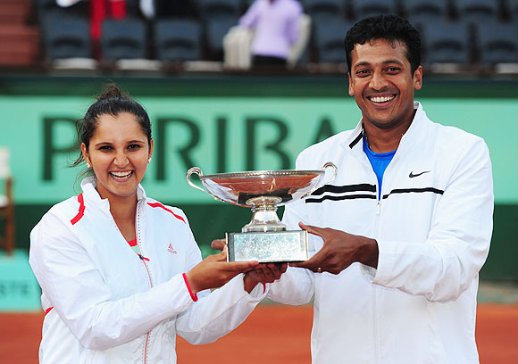 Sania Mirza and Mahesh Bhupathi pose with the winners trophy after winning the French Open mixed doubles final at Roland Garros on Thursday