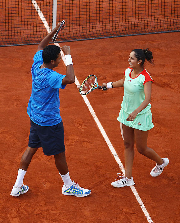 Sania Mirza and Mahesh Bhupathi celebrate after defeating Klaudia Jans-Ignacik of Poland and Santiago Gonzalez of Mexico in the French Open mixed doubles final