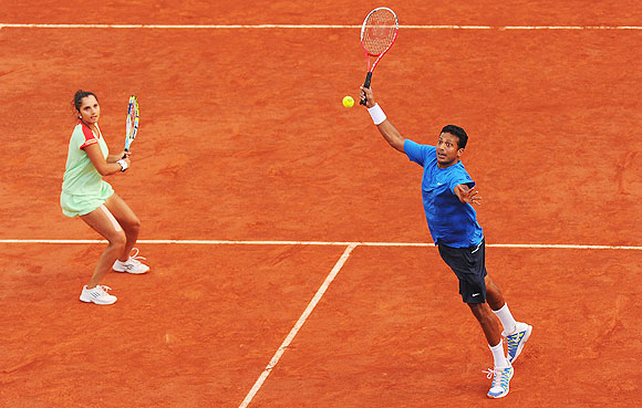 Sania Mirza and Mahesh Bhupathi in action during the mixed doubles final on Thursday