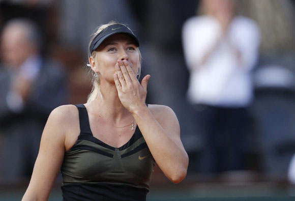 Maria Sharapova of Russia celebrates after winning her women's semi-final match against Petra Kvitova of the Czech Republic at the French Open