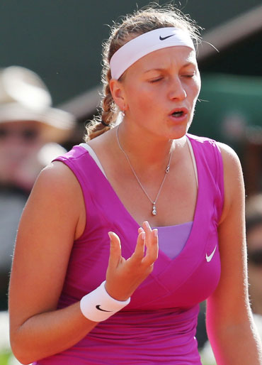 Petra Kvitova of the Czech Republic reacts during her women's semi-final match against Maria Sharapova of Russia at the French Open