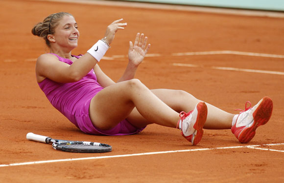 Sara Errani of Italy reacts after winning her women's semi-final match against Samantha Stosur of Australia at the French Open
