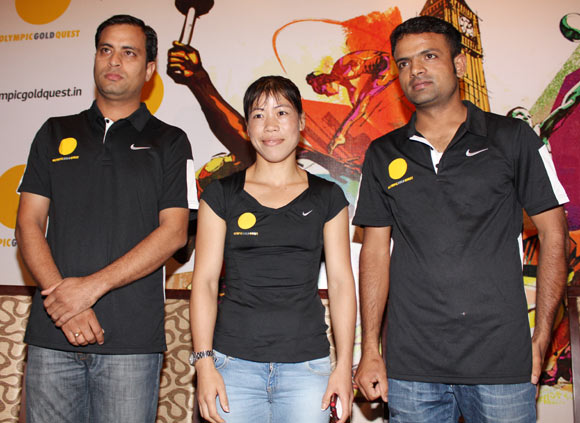 Sanjeev Rajout, Mary Kom and Vijay Kumar at an OGQ function in Mumbai on Thursday