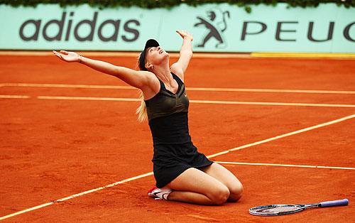 Maria Sharapova falls to her knees as she soaks in the applause after match point in the women's singles final