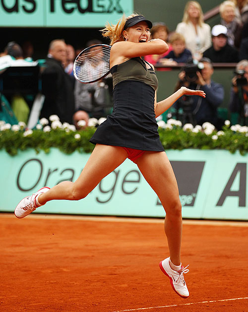 Maria Sharapova plays a forehand