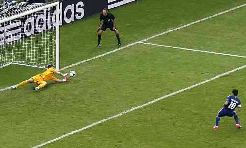 Poland's goalkeeper Tyton saves a penalty taken by Greece's Karagounis