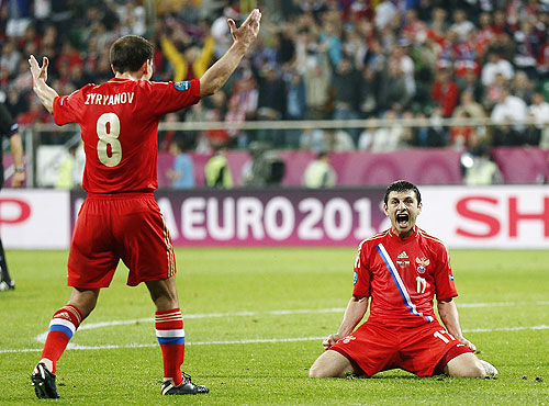 Russia's Alan Dzagoev (right) celebrates with teammate Konstantin Zyryanov on scoring his second goal against Czech Republic